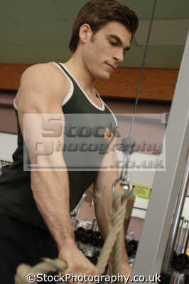 man lifting exercises gym gymnasium health clubs exercise physical athletic aerobic anaerobic fitness people persons