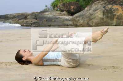 beach yoga enlightenment. karma bhakti jnana raja hatha relaxation posture physical exercise athletic aerobic anaerobic health fitness people persons