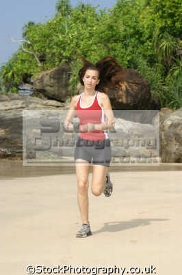 jogging beach physical workout health fitness people persons running