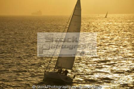 boats solent sunset uk. yachts yachting sailing sailboats marine misc. uk sea shipping boat isle wight england english great britain united kingdom british