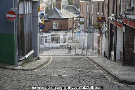 macclesfield town old buildings cobbled street uk towns environmental hill road pavement downhill peak district derbyshire england english great britain united kingdom british