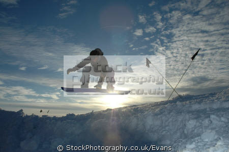 snowboarder leaping crossed flags polar natural history nature misc. snowboarding extreme antarctic antarctica united kingdom british