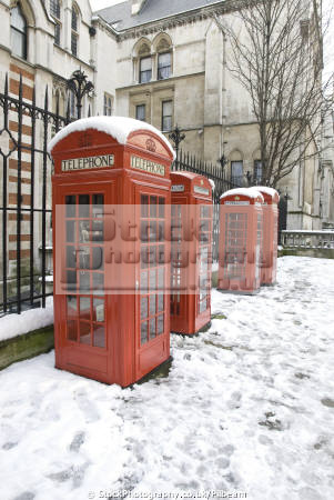 phone boxes snow outside entrance law courts strand famous sights london capital england english uk red box city cockney great britain united kingdom british
