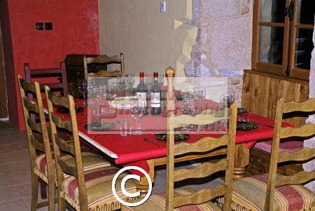 dinner table french gite waiting guests. european travel chairs wine glasses plates cutlery cloth place settings mealtime correze limousin france la francia frankreich europe