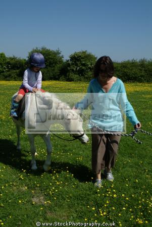child supervised learning ride horse rural britain countryside rustic pastoral environmental learn cornwall cornish england english angleterre inghilterra inglaterra united kingdom british