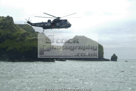 helicopter air sea rescue chopper arrives rnli coastguard lifeboat uk emergency services lizard cornwall cornish england english angleterre inghilterra inglaterra united kingdom british