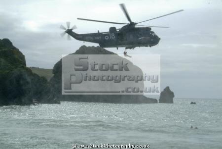 helicopter air sea rescue rescuer winched rnli coastguard lifeboat uk emergency services lizard cornwall cornish england english angleterre inghilterra inglaterra united kingdom british