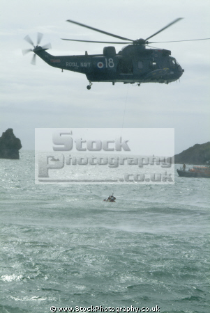 helicopter air sea rescue rescuer secures victim rnli coastguard lifeboat uk emergency services lizard cornwall cornish england english angleterre inghilterra inglaterra united kingdom british