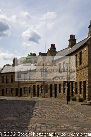 regenerated merchant crescent sheffield canal basin uk terraced houses british housing homes dwellings abode architecture architectural buildings cobble street bygone united kingdom