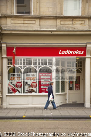 man walking past ladbrokes branch scarborough north yorkshire uk shops commercial buildings retailers british architecture architectural betting shop chain street bookmakers gambling england english angleterre inghilterra inglaterra great britain united kingdom grande-bretagne grande bretagne grandebretagne großbritannien gran bretagna bretaña