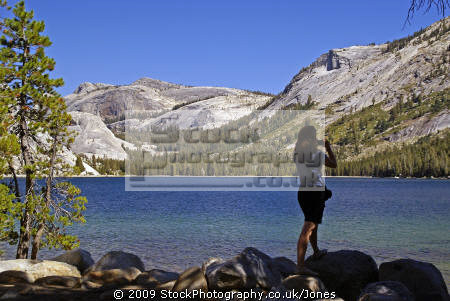 photographer checks tioga lake yosemite national park. wilderness natural history nature misc. california sierra nevadas mountains alpine pristine turquoise np californian usa united states america american