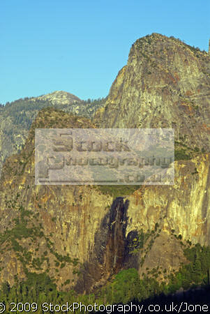 yosemite national park valley bridalveil falls lit setting sun taken tunnel view wilderness natural history nature california sierra nevadas mountains alpine np twilight sunset evening geology earth sciences californian united states american
