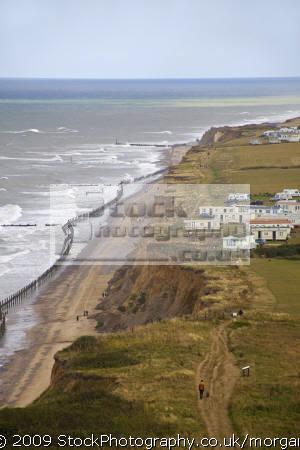 cliff erosion close caravan park cromer norfolk uk coastline coastal environmental collapse beach seaside caravans danger united kingdom british