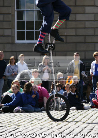 performing edinburgh festival street performers buskers arts misc. public unicycle performance busking united kingdom british