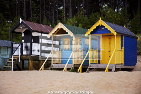 beach huts wells sea norfolk unusual british buildings strange wierd brightly painted holiday wooden colourful stilts england english angleterre inghilterra inglaterra united kingdom