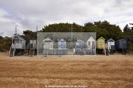 beach huts wells sea norfolk unusual british buildings strange wierd brightly painted holiday wooden stilts england english angleterre inghilterra inglaterra united kingdom
