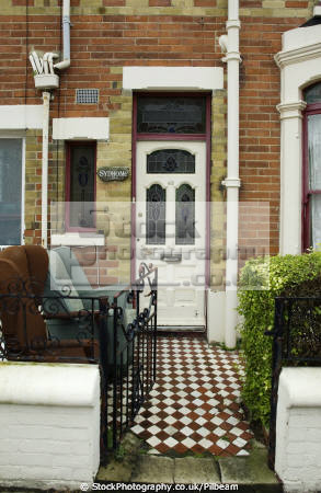 victorian terraced house door old chairs outside uk houses british housing homes dwellings abode architecture architectural buildings furniture dumped street portsmouth pompey hampshire hamps england english angleterre inghilterra inglaterra united kingdom