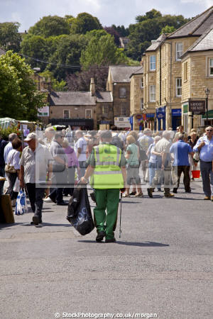 cleansing services employee duty bakewell market derbyshire uk markets traders commercial buildings retailers british architecture architectural crowd people walking uniform equipment england english angleterre inghilterra inglaterra united kingdom