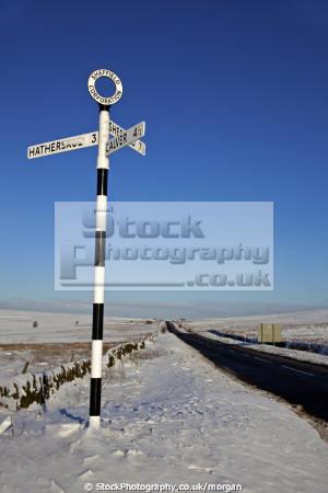 sign post near fox house longshaw derbyshire countryside rural environmental winter snow remote directions road roadside peak district england english angleterre inghilterra inglaterra united kingdom british