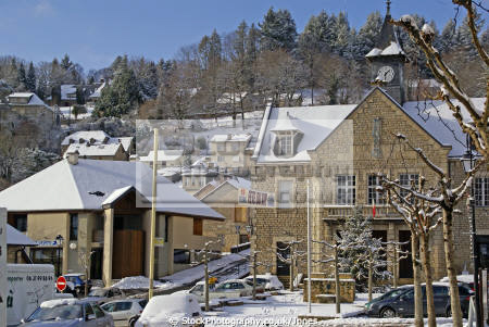 village square mairie correze france french buildings european mayor town hall limousin snow snowy winter wintery christmas card picture post mediaeval medaeval corrèze la francia frankreich