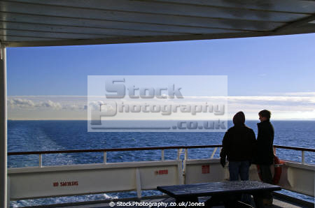 couple cross channel ferry dover looking france seascapes scenery scenic english sous la manche french horizon shipping nautical navigation north sea romantic wistful kent england angleterre inghilterra inglaterra united kingdom british