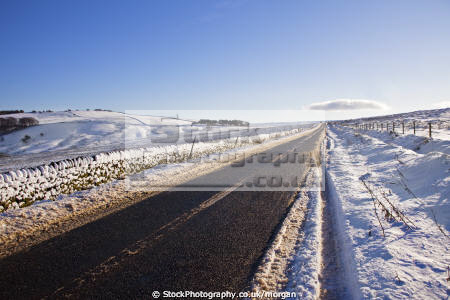 road winter strines sheffield south yorkshire countryside rural environmental snow landscape straight dry stone wall england english angleterre inghilterra inglaterra united kingdom british