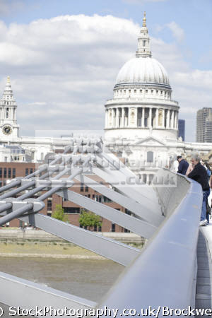 millenium bridge london tourists crossing st pauls cathedral background famous sights capital england english stucture architecture sigh-seeing sigh seeing sighseeing tourism landmark building cockney angleterre inghilterra inglaterra united kingdom british