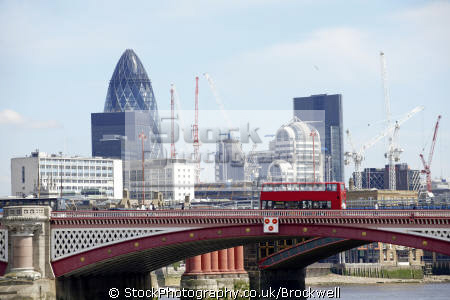 london bridge thames red double decker buses financial district capital background city famous sights england english skyline river buildings business cockney angleterre inghilterra inglaterra united kingdom british