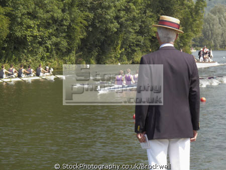 spectator steward wearing boater hat jacket club colours watching race royal henley regatta thames river rowing rowers sport sporting celebrities celebrity fame famous star boats row referee summer event competition henley-on-thames henley on thames henleyonthames oxfordshire home counties england english angleterre inghilterra inglaterra united kingdom british