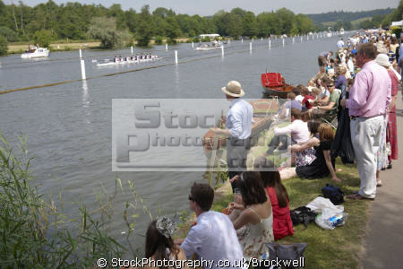 spectators watching rowing race royal henley regatta oxfordshire thames riverside summer.men summer men summermen women sitting river bank sun facial expressions emotions emotional nonverbal communication body language competition berkshire watch club enclosure henley-on-thames henley on thames henleyonthames home counties england english angleterre inghilterra inglaterra united kingdom british