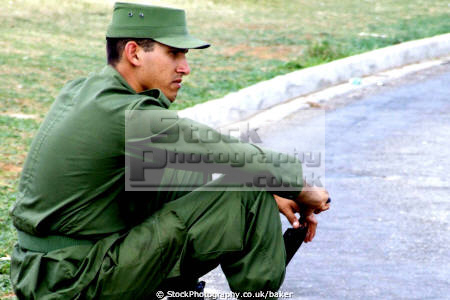 cuban soldier havana cuba men adult males masculine manlike manly manful virile mannish military armed communism communist fidel castro che guevara caribbean