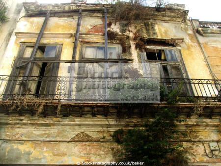 colonial building havana cuba walls abstracts tatty worn rotten wood balcony washing line mediterranean paint window caribbean cuban