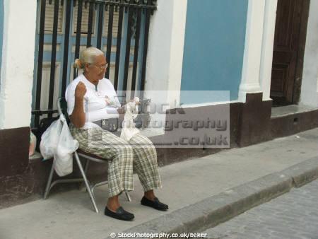 old lady knitting havana cuba elderly women aged senior woman female females feminine womanlike womanly womanish effeminate ladylike caribbean cuban