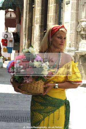 lady selling flowers havana cuba women woman female females feminine womanlike womanly womanish effeminate ladylike colonial mediterranean spanish colourful colorful che guevara caribbean cuban