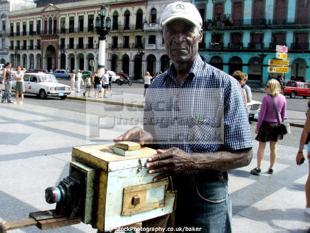 man old pin hole box camera outside capitolio havana cuba photography imaging arts photographic colonial tourist attraction photograph polaroid caribbean cuban