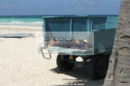 man sunbathing beach cayo coco cuba relaxing contemplating sunshine truck caribbean cuban