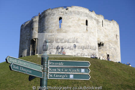 clifford tower york sign post showing direction different historic buildings tourist attractions city british castles architecture architectural medieval castle tourism yorkshire sight seeing fortress england english angleterre inghilterra inglaterra united kingdom