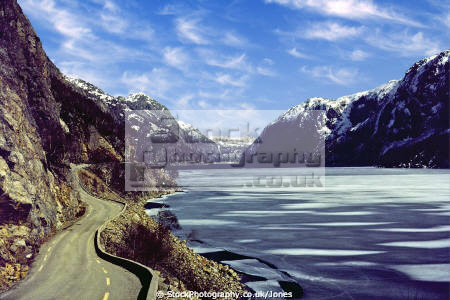 ice-covered ice covered icecovered austrumdalsvatnet fjord western norway wilderness natural history nature valley lake norwegian winter plates norge refrozen snow mountains cirrus kongeriket norwegan