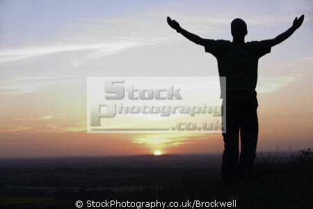 man standing arms stretched looking sunset landscape sun setting horizon country buckinghamshire sunsets sky natural history nature environment high wycombe bucks england english angleterre inghilterra inglaterra united kingdom british