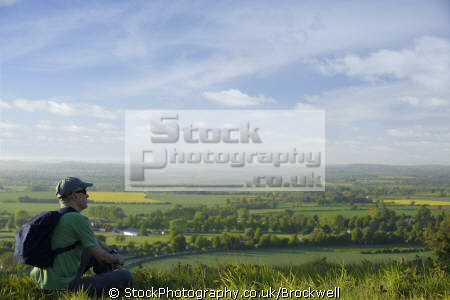 man sitting landscape resting walk hike rucksack looking country fields buckinghamshire chilterns physical exercise athletic aerobic anaerobic health fitness environment high wycombe bucks england english angleterre inghilterra inglaterra united kingdom british