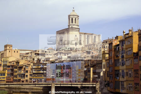 girona spain apartments businesses lining river onyar. distance cathedral catalunya catalonia spanish espana european església church tower religious catholic espagne españa catedral bridge costa brava spanien la spagna