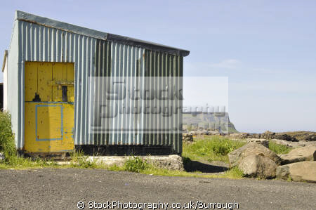 metal shed yellow door industry industrial uk business commerce corrugated dunseverick harbour padlock county antrim aontroim northern ireland ulster irish irland irlanda united kingdom british