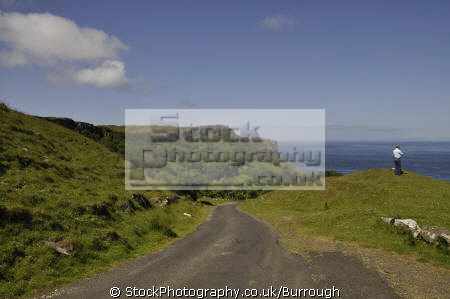 man clifftops murlough bay looking sea cliff causeway coast views tourist county antrim aontroim northern ireland ulster irish irland irlanda united kingdom british