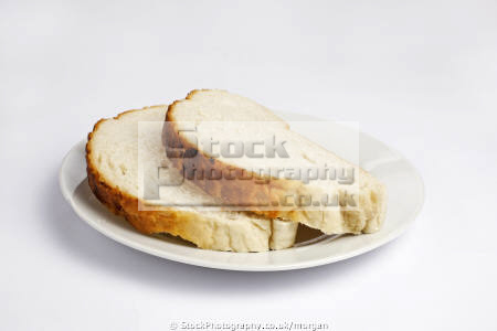 slices bread food nourishment nutrients abstracts cut fresh plate white background united kingdom british