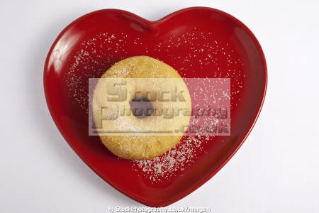 doughnut heart shaped plate food nourishment nutrients abstracts confectionary white background uk united kingdom british