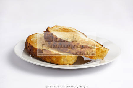 slices toast food nourishment nutrients abstracts plate bread toasted breakfast white background united kingdom british