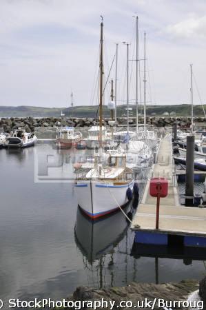sailing boat ballycastle harbour boats marine sail reflections county antrim aontroim northern ireland ulster irish irland irlanda united kingdom british