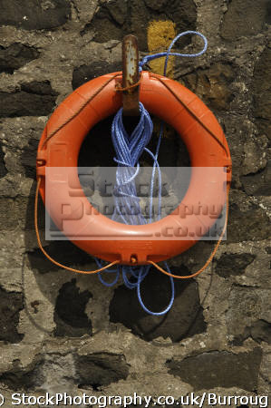 lifebouy blue rope docks uk coastline coastal environmental safety device sea floatation county antrim aontroim northern ireland ulster irish irland irlanda united kingdom british