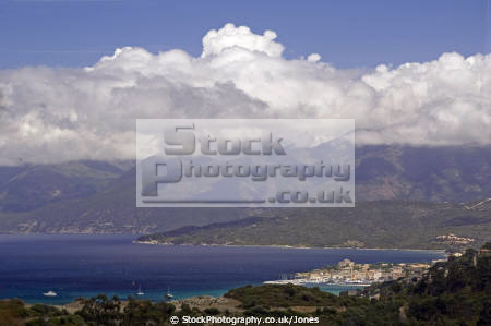 golfe saint-florent saint florent saintflorent corsica dramatic clouds town st florent mountains cap corse french landscapes european weather meteorology formation cumulus rain shower storm precipitation updraft thermals saint granite island france la francia frankreich