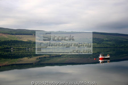 small red boat hills reflecting loch near furnace scottish lochs british lakes countryside rural environmental reflection early morning argyll bute argyllshire scotland scotch scots escocia schottland united kingdom